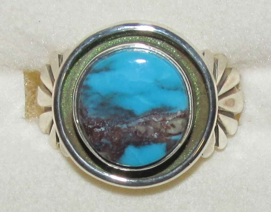 Classic Bisbee Turquoise with brown / lavender matrix or host rock